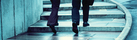 2 people walking up stairs.