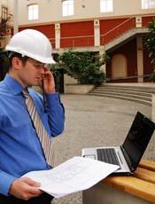 engineer looking at laptop