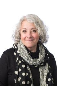 Ms. Judy Shandler, smiling.