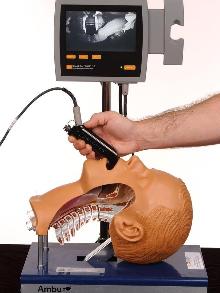 Laryngoscope intibation device being tested on dummy.
