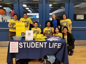 group of student life ambassadors in yellow t-shirts at a games day event
