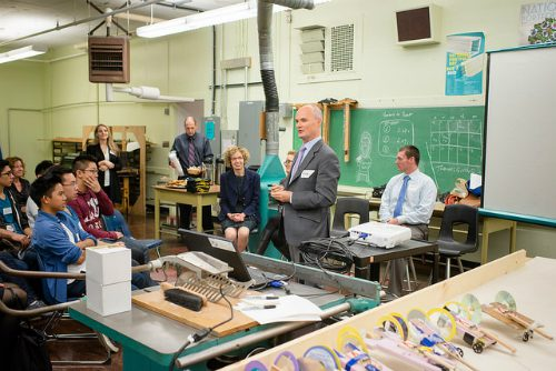 Image of an employee from SAP speaking to a group of people in a classroom.