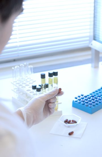 Photo of researcher holding sample vials.