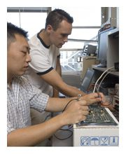 two technicians working on machines