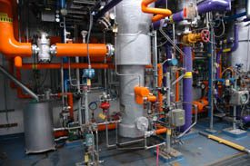 Conglomeration of pipes of various colours and sizes.
