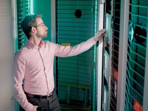 Man looking at control panel in a server room
