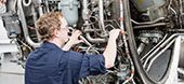 technician working on airplane wiring.