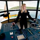 Person at a marine control panel.