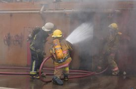 firefighters spraying water.