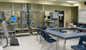 classroom with pipes & gauges along far wall.