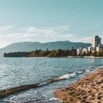Vancouver landscape of beach, city and mountains.