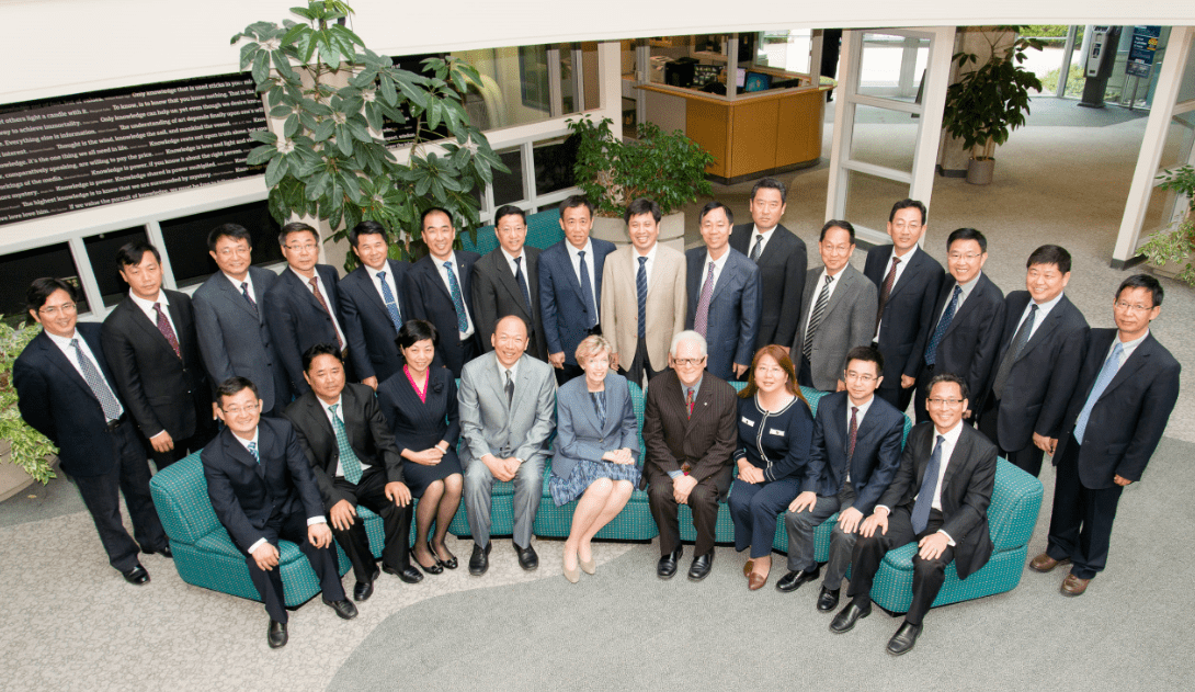 Executives posing for a group photo with BCIT president, Kathy Kinloch.