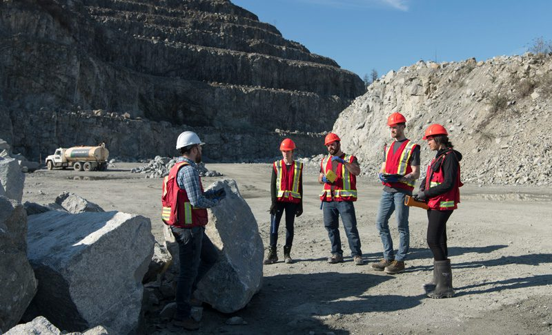 Mining students visiting a site.