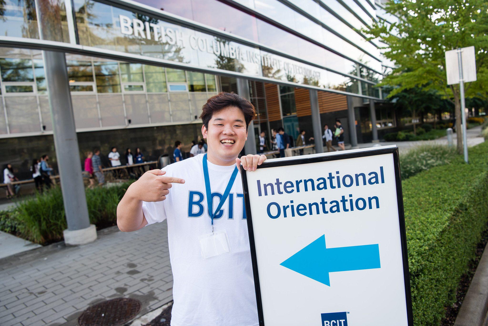 Smiling student volunteer at BCIT International Orientation
