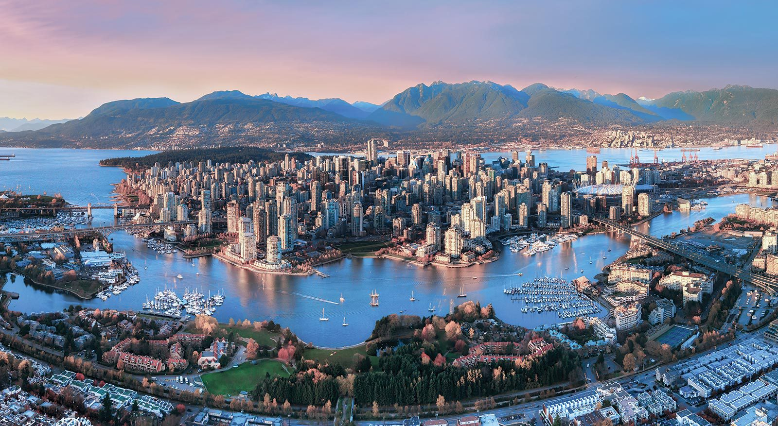 Aerial view of downtown Vancouver and mountains
