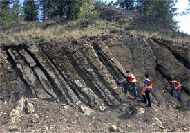 Students examining exposed rock face near BCIT's Field School, Oliver, B.C.