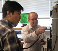 instructor showing a student an electrical panel