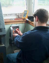 person looking at control panel