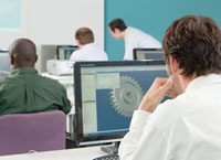 computer lab with students and a teacher