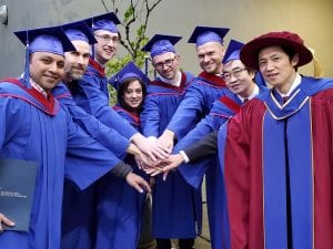 TMGT graduates with instructor, Chang Han, pictured far right, at the February 2020 Convocation ceremony