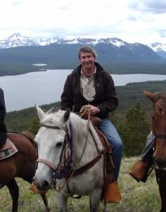 Ken Ashely on a horse with river as the background