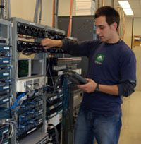 male in blue shirt looking at servers