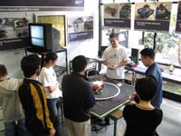 five male students stood around a table with mechanical items on it