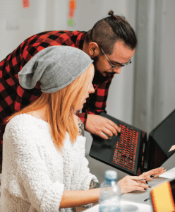 Two students looking at a laptop.