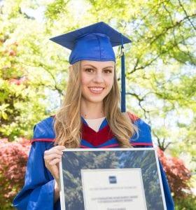 BCIT Graduate in cap and gown