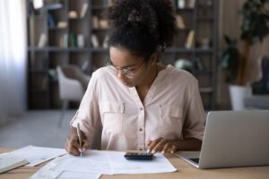 Female student works on a budget worksheet